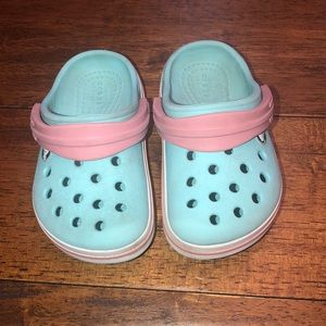 Pink and light blue crocs